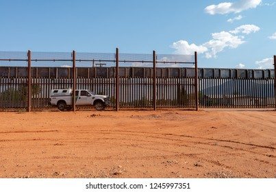 June 20, 2017 - Naco, Arizona. High fence dividing the United States and Mexico. Border patrol waiting for illegal immigrants to cross.