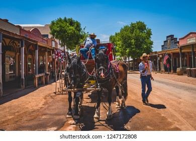 June 20, 2017 - Tombstone, Arizona, USA is a Wild West mining town with historic buildings and actors that are a popular tourist attraction. Historic Allen street with a horse drawn stage coach.