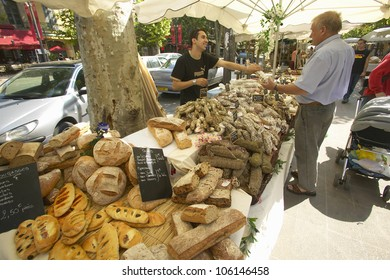 JUNE 2004 - Outdoor market, bread seller in Aix en Provence, France