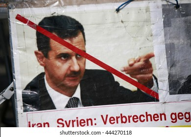 JUNE 2016 - BERLIN: a protest poster with a portrait of Syrian dictator Baschar Hafiz al Assad at a demonstration against Iranian human rights violations at the Pariser Platz in Berlin.