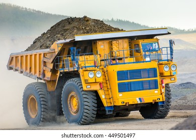 June, 2016 - Buryatia, Russia: Trucks working in open pit.