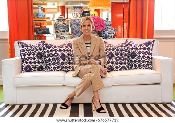 june 2016 - Tory Burch posing in her showroom in Milan during the fashion week