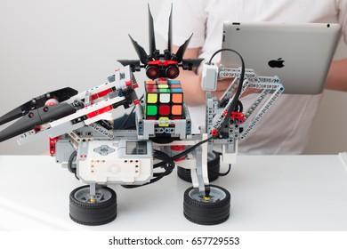 June, 2017. Minsk, Belarus. A boy and a lego robot. IPad Apple. Tablet. School of Robotics. STEM education. Rubik's Cube.