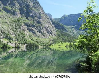 Schöngau am Königssee in June 2017: Natinoal Park Berchtesgaden with Königssee and upper lake in front of Watzmann massif in Bavaria, Germany
