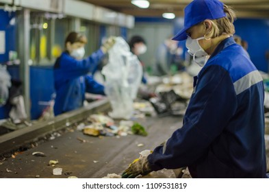 June, 2018 - Arkhangelsk. Garbage processing. Waste processing plant. Woman working
