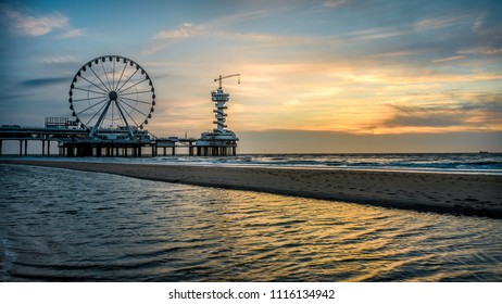June 2018, Beautiful sunset at the beach of Scheveningen in the Netherlands with the famous Pier in the background