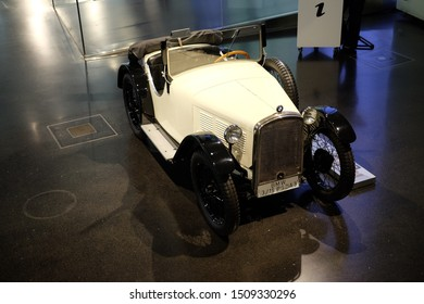 June 2018: BMW Welt museum. Front view of vintage white car, model BMW 3 15 PS DA 3, year 1930.