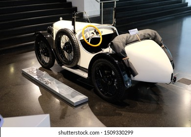 June 2018: BMW Welt museum. Back view of vintage white car, model BMW 3 15 PS DA 3, year 1930.