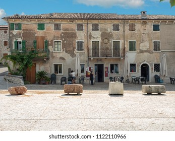 June 2018. Cleaning of the courtyard in front of the central bar in the village of San Giorgio di Valpolicella a fraction of the municipality of Sant'Ambrogio di Valpolicella, in the province of Veron