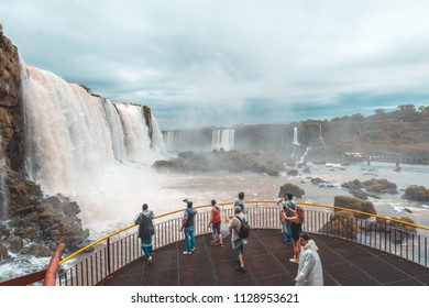 June 2018. Iguassu Falls. Tourists visiting the falls on the Brazilian side during the winter on a rainy day.