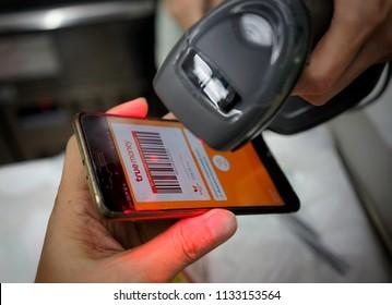 June, 2018 : man scanning barcode on app seven eleven mobile ( true wallet ) at seven eleven shop at Bangkok,Thailand