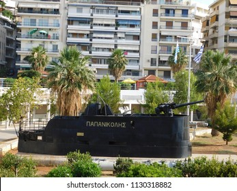 "June 2018, Piraeus, Greece. The conning tower and gun of an old submarine, at the Naval museum. The inscription is its name ""Papanikolis"""
