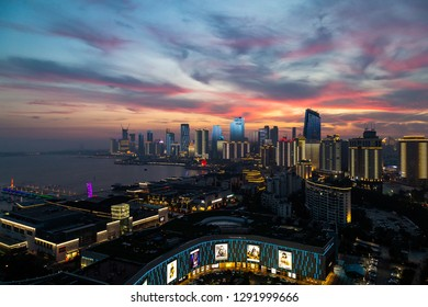 June 2018 - Qingdao, China - Sunset on Olympic Sailing Center. The new lightshow of Qingdao skyline created for the SCO summit between China and Russia of June 2018 is about to start