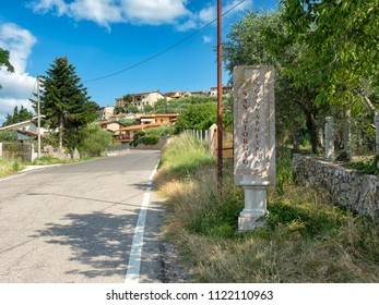 June 2018. Red Verona marble road sign indicating the name of the town San Giorgio di Valpolicella a fraction of the municipality of Sant'Ambrogio di Valpolicella, in the province of Verona. italy