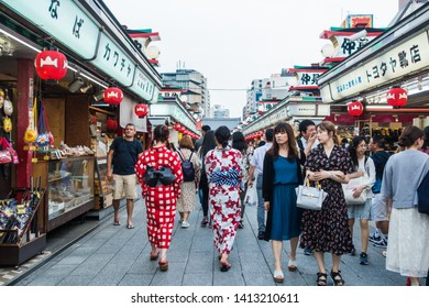 June 2019 - Tokyo, JAPAN: Tourist shopping at Nakamise Street, famous shopping street at Asakusa Sensoji Temple. Many will wear rental kimono and enjoy the Japanese culture.
