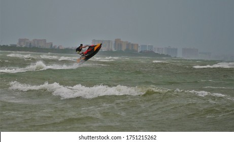 June 2020, Dunedin, FL Jets skiers playing with waves in Dunedin, Florida, Honeymoon Island State Park during tropical storm Cristopal that did not develop into a hurricane