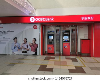 June 20/2019 OCBC Bank ATM station at People park Centre by night, Singapore