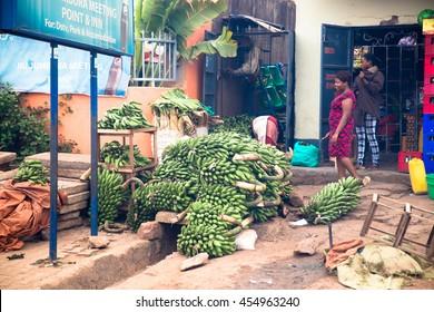 June 21, 2016: A woman sells bananas at her road-side store in Kampala, Uganda