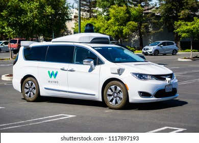 June 21, 2018 Mountain View / CA / USA - Close up of Waymo self driving car performing tests in a parking lot near Google's headquarters, south San Francisco bay area