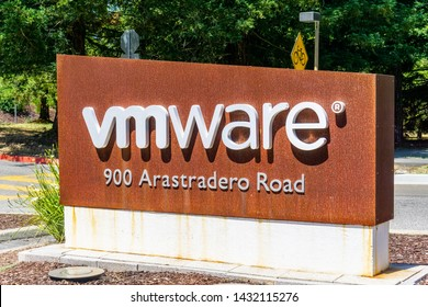 June 21, 2019 Palo Alto / CA / USA - Sign located at the entrance to VMware offices located in Silicon Valley; VMware provides cloud computing and platform virtualization software and services