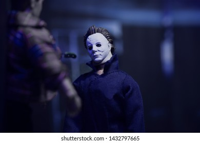 JUNE 21 2019: Recreation of a scene from the 1978 movie Halloween by John Carpenter, where Michael Myers hangs Bob to a kitchen door with a butcher knife - Custom and Mego style action figures