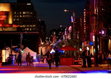 June 22, 2017 - Montreal, Quebec, Canada. Ste-Catherine Street at Place des Arts in the midst of preparations for St-John-Baptiste- Day.