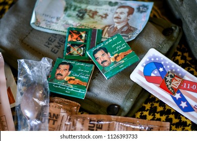 June 22 2018 St Joseph MI USA; memorabelia from the iraqi war; match books with the portrait of Saddam Hussein, iraqi currancy,  MRE packets and USA pin