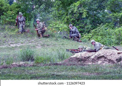 June 22 2018 St Joseph MI USA , lest we forget event; soldiers in vintage uniforms from the korean and vietnam war, act in a mock battle