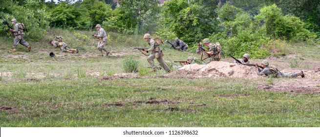 June 22 2018 St Joseph MI USA ; soldiers in vintage uniforms from the korean and vietnam war, act in a mock battle during this reenactment event during 'least we forget'