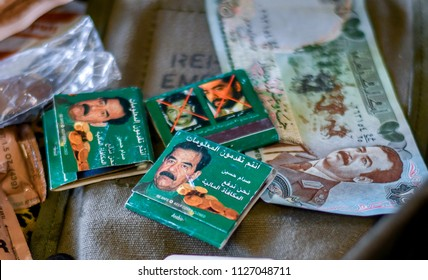 June 22 2018 St Joseph MI USA; a still life display of match books and money with photos of saddam Hussein and most wanted terrorists on them, are showcased at the Lest we forget event