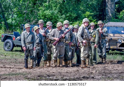 June 22 2018 St Joseph MI USA ; a group of soldiers in vintage uniforms from the vietnam war era, pose before a mock battle during the Lest we forget event in Michigan