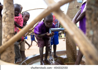 June 23, 2016: Soroti, Uganda. School children drink from a water well built by the organization Drop in the Bucket.