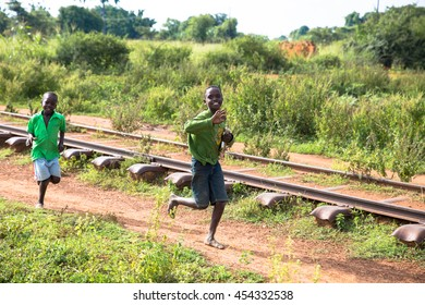 June 23, 2016: Soroti, Unganda. School boy runs after a van as visitors from Drop in the Bucket leave.