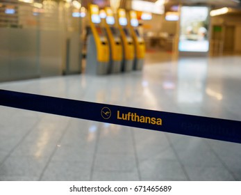 June 23, 2017. Close-up detail of a Lufthansa logo on a retractable queue barrier at the check-in counters at Frankfurt Airport, Germany. Travel and industry concept.