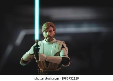JUNE 23 2021: Star Wars The Clone Wars Jedi General Obi Wan Kenobi  with lightsabers in battle - Hasbro action figure
