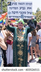 June 24, 2016 The Central Carmel. Haifa. Israel. The parade of pride. A man in a green dressing gown with a placard over his head