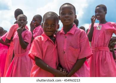 June 24, 2016: Friends hold hands at a school in Soroti, Uganda