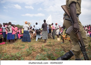 June 24, 2016: School children perform an African dance in Soroti, Uganda while a military soldier walks by