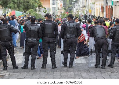 June 24, 2017 Cotacachi, Ecuador: Ecuadorian police standing by during summer solstice festival which ends up violent occasionally