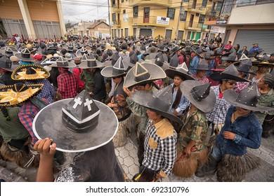 June 24, 2017 Cotacachi, Ecuador: aindigenous kichwa men dancing at the Inti Raymi parade at summer solstice events