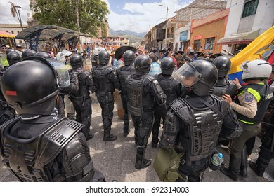 June 24, 2017 Cotacachi, Ecuador: riot police on duty at the Inti Raymi parade at summer solstice