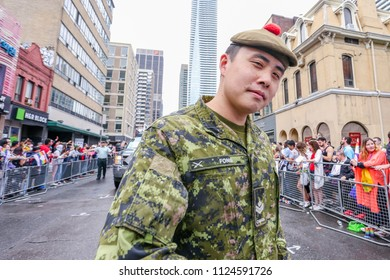 JUNE 24, 2018 - TORONTO, CANADA: MEMBERS OF CANADIAN MILITARY MARCH AT 2018 TORONTO PRIDE PARADE.