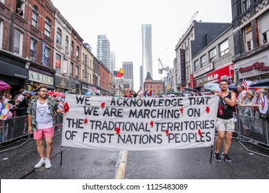 JUNE 24, 2018 - TORONTO, CANADA: Indigenous Rights activists march at 2018 Toronto Pride Parade.