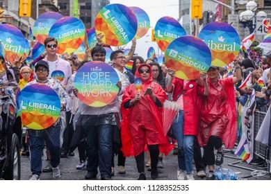 JUNE 24, 2018 - TORONTO, CANADA: LIBERAL PARTY OF CANADA MARCHES AT 2018 TORONTO PRIDE PARADE.