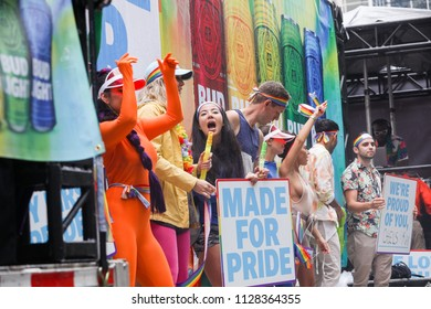 JUNE 24, 2018 - TORONTO, CANADA: BUD LIGHT EMPLOYEES MARCH ON FLOAT AT 2018 TORONTO PRIDE PARADE.