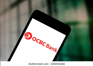 June 24, 2019, Brazil. In this photo illustration the Oversea-Chinese Banking Corporation (OCBC) logo is displayed on a smartphone.