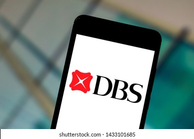 June 24, 2019, Brazil. In this photo illustration the DBS Bank Limited logo is displayed on a smartphone.