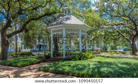 JUNE 28, 2017 - SAVANNAH GEORGIA - Historic Savannah Georgia in early summer features a white gazebo in one of many town parks
