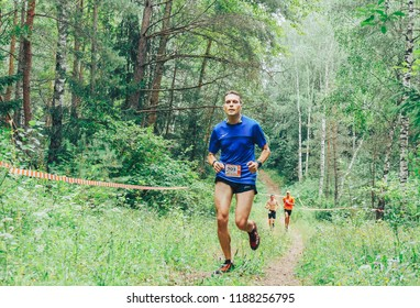 June 28, 2018 Raubichi Belarus Beetle trail 7 Raubichi A man is running along a forest trail