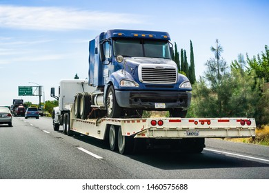 June 28, 2019 Tracy / CA / USA - Truck towing another truck